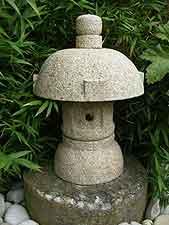 Small round-top granite lantern